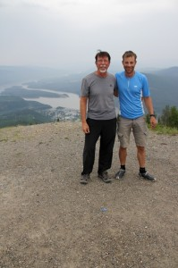 Colin and Steve celebrating their arrival in Dawson City. Yukon River pictured behind.
